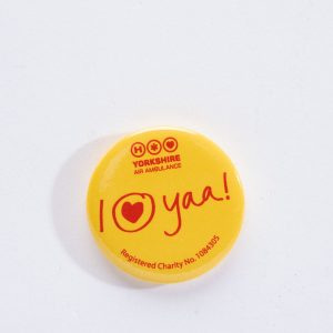 YAA Yellow Button Badge