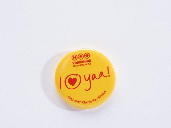 YAA Yellow Button Badge