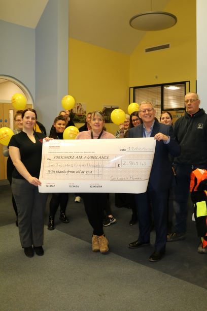 St Leger Homes with a cheque for the YAA