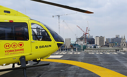 Yorkshire Air Ambulance helicopter on a helipad
