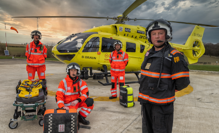 Image of Yorkshire Air Ambulance Doctor and Paramedics in front of helicopter