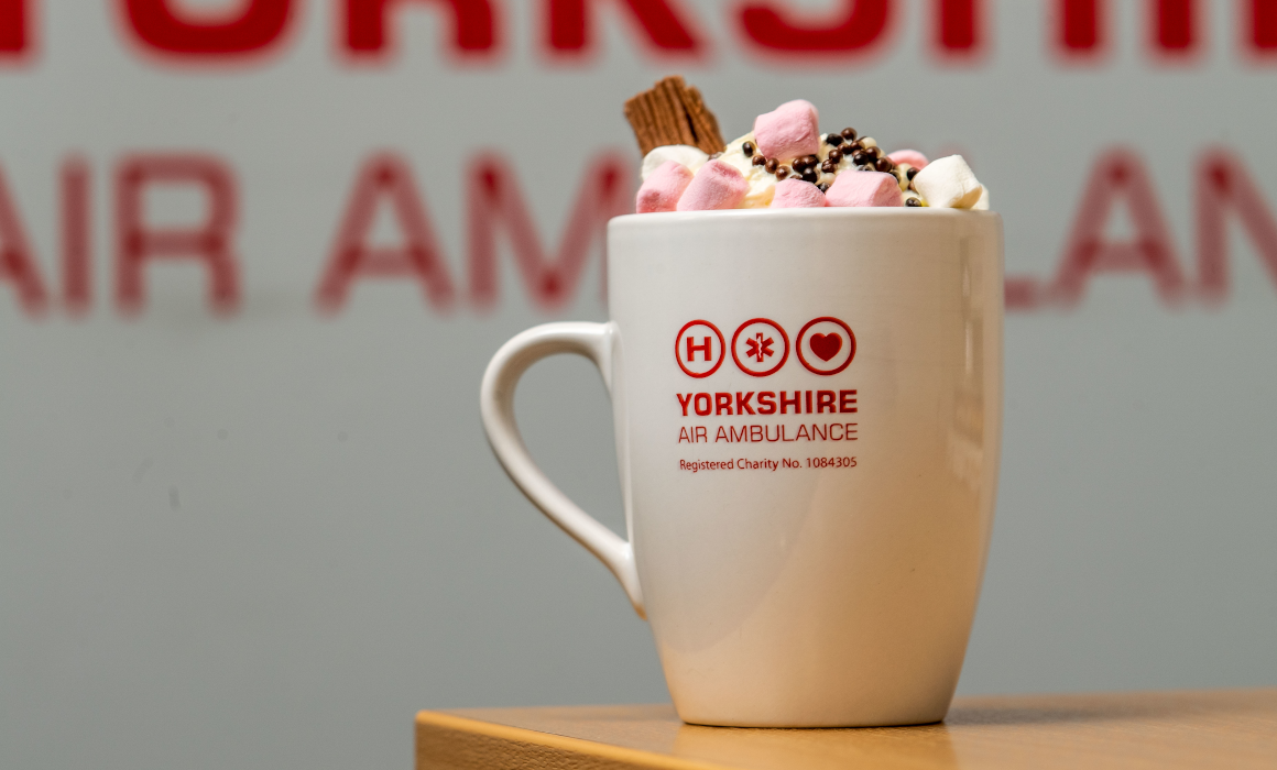 An image of a hot chocolate in a Yorkshire Air Ambulance mug