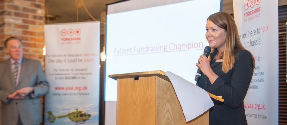 Image of Kerry Dwyer, Yorkshire Air Ambulance Director of Fundraising West & South, speaking at an event