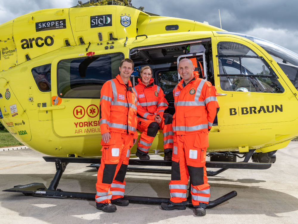 Image of 3 Yorkshire Air Ambulance HEMS Paramedics with helicopter