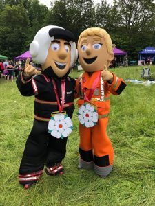 Image of Percy and Polly with the medals after the 2019 Run for Jo Mascots' Race