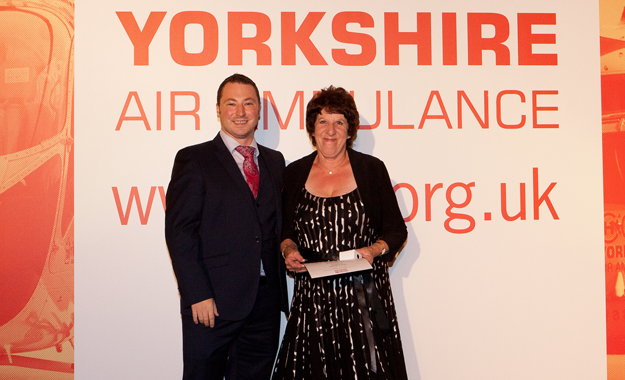 Image of YAA Volunteer Liz Storey receiving an award