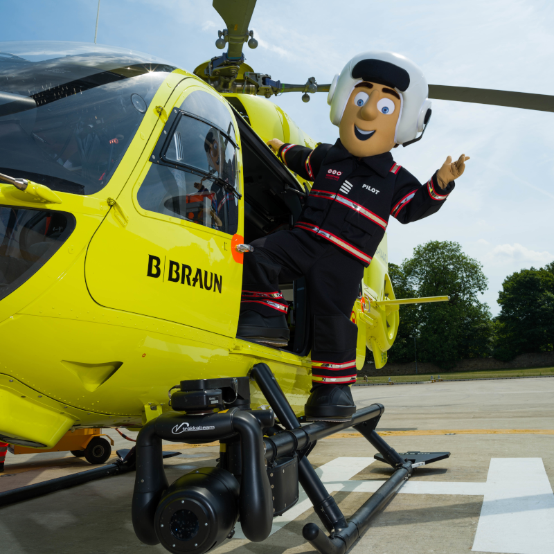Image of Yorkshire Air Ambulance mascot Percy Pilot with helicopter