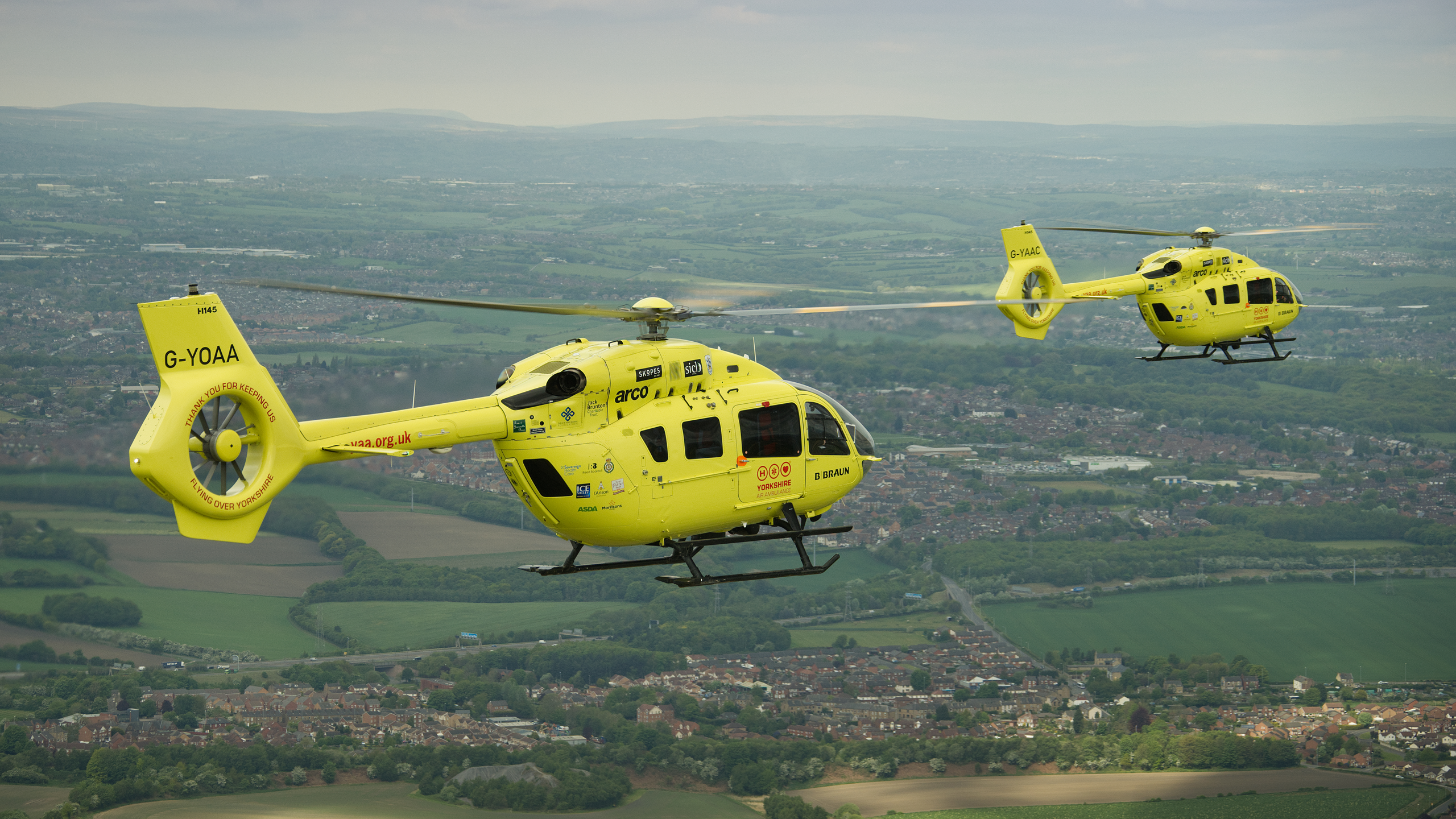 Image of both Yorkshire Air Ambulance helicopters flying over Yorkshire