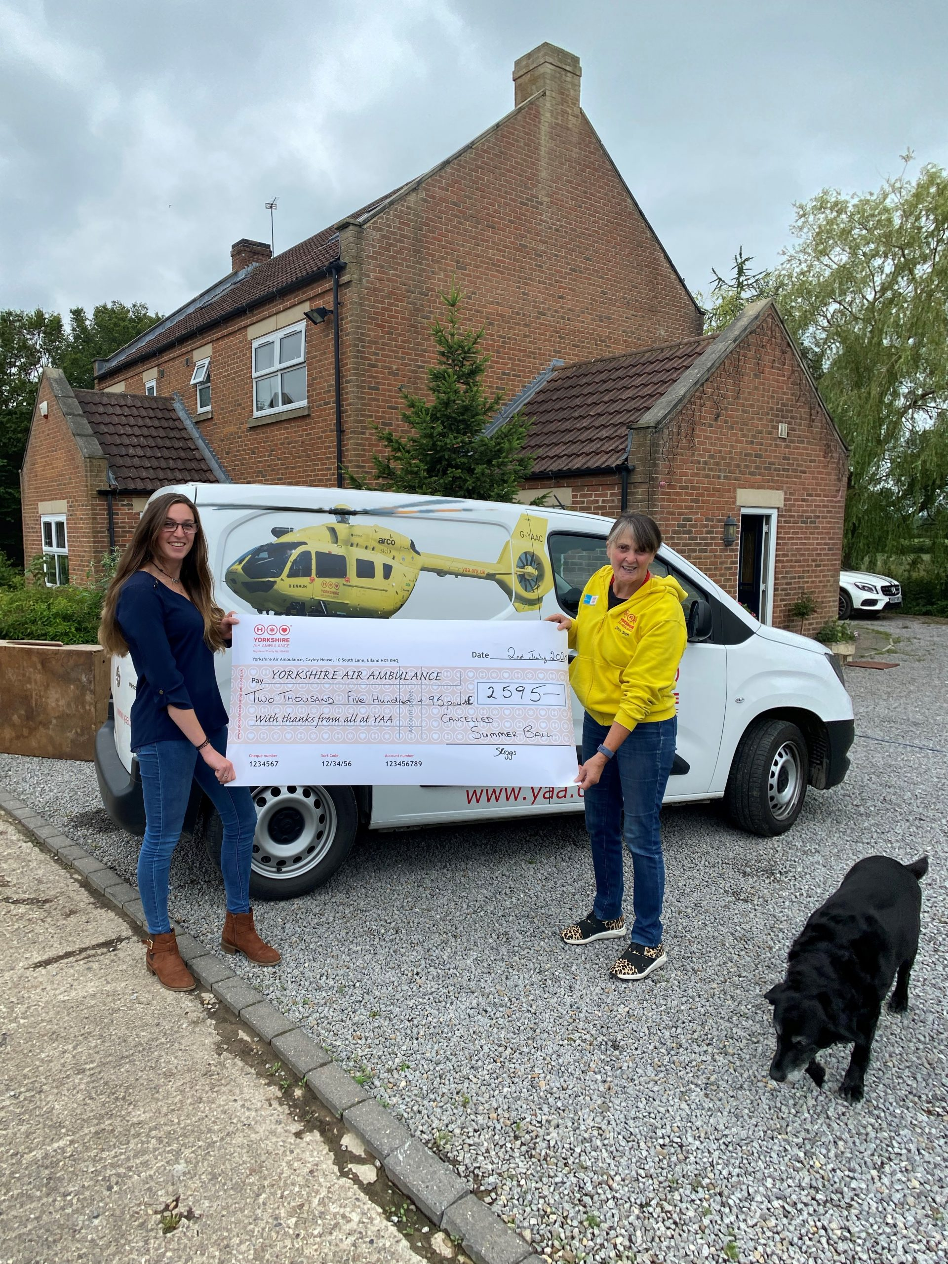 Sophie Riggs with a cheque for the YAA