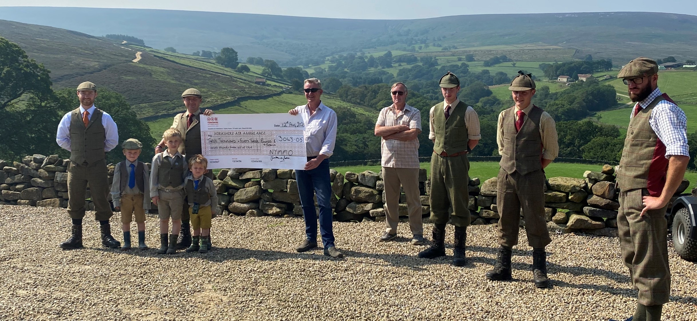 Moorland Organisation with a cheque for the YAA