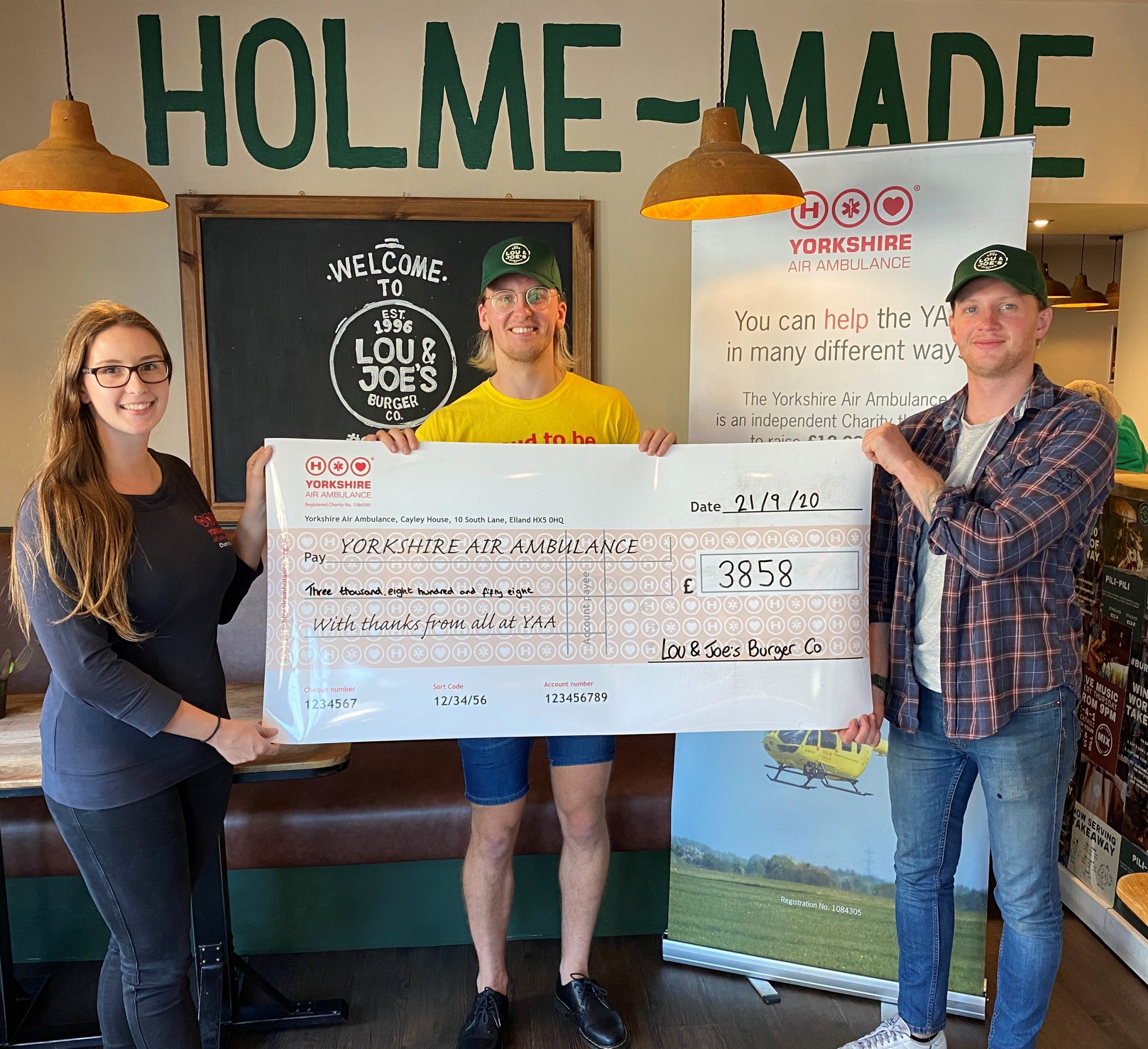 Lou & Joe's Burger Co with a cheque for the YAA