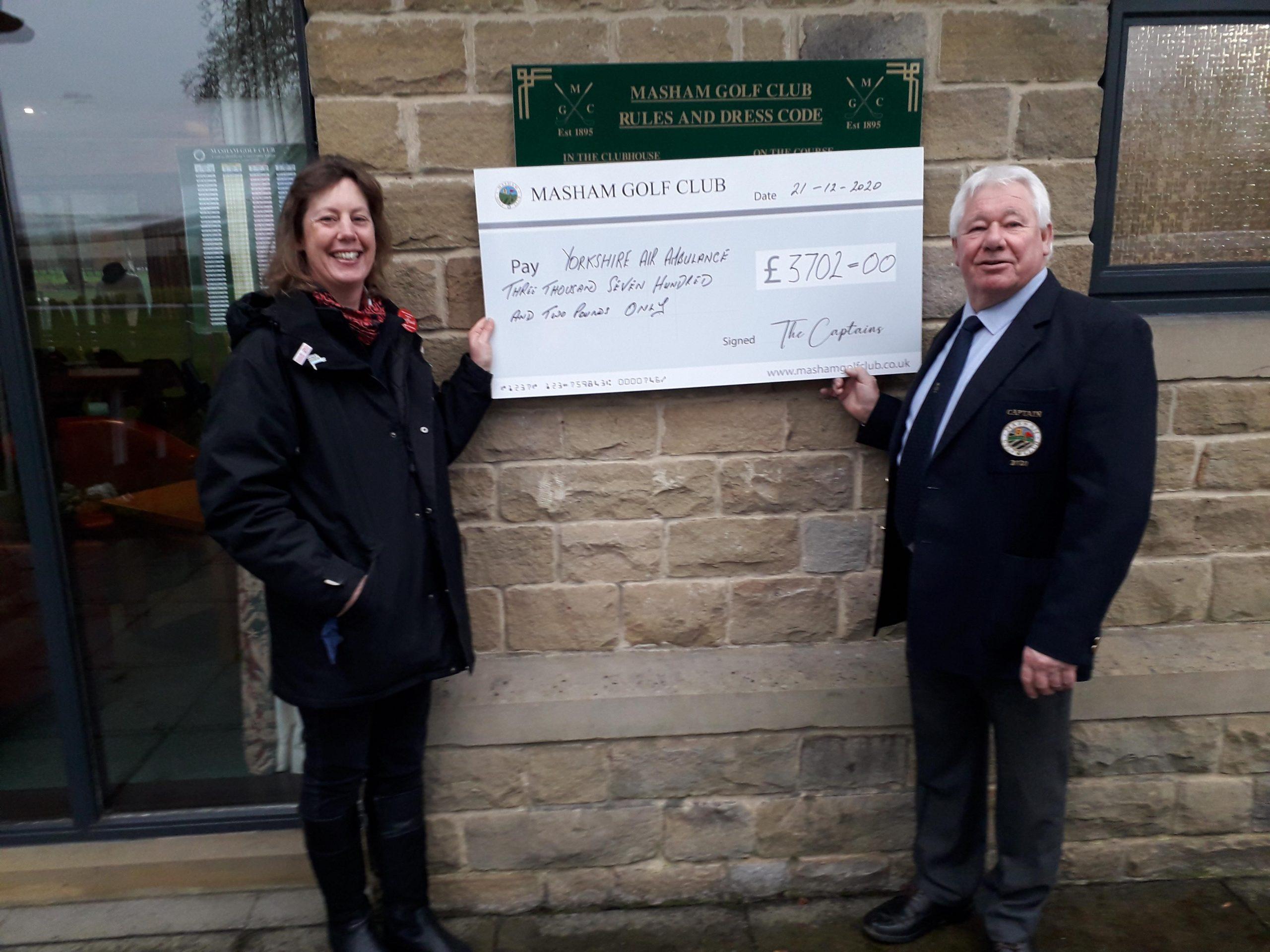 Masham Golf Club with a cheque
