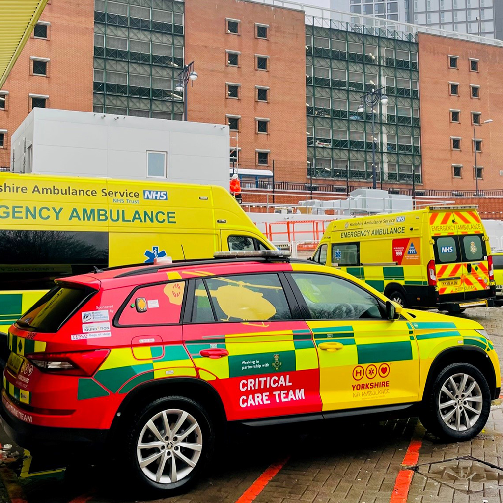 Yorkshire Air Ambulance Rapid Response Vehicle with ambulances in the background
