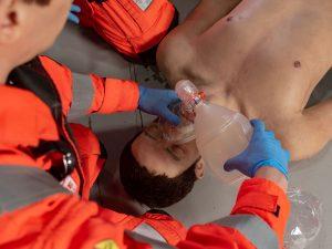 Image of YAA Crew training with life-like training manikin