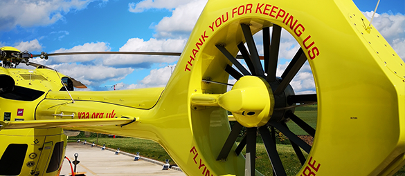 This image shows the back of one of the Yorkshire Air Ambulance Helicopters which displays the words Thank you for keeping us flying over Yorkshire