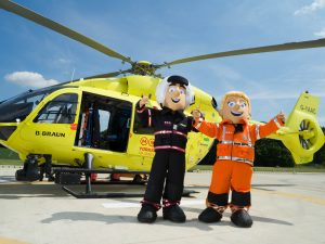Yorkshire Air Ambulance mascots stood in front of helictoper