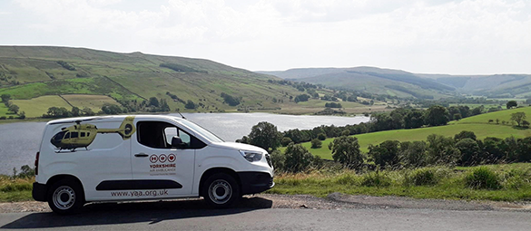Image shows a Yorkshire Air Ambulance fundraising van on the road above Semerwater in North Yorkshire