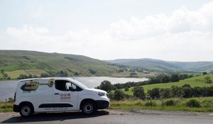 Yorkshire Air Ambulance fundraising van with body of water behind