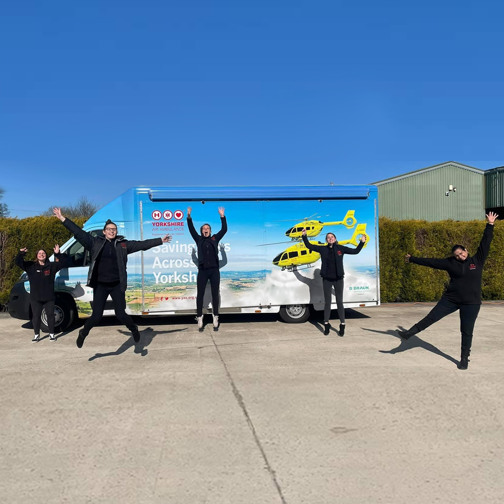 Members of the Yorkshire Air Ambulance fundraising team in from of their promotional vehicle