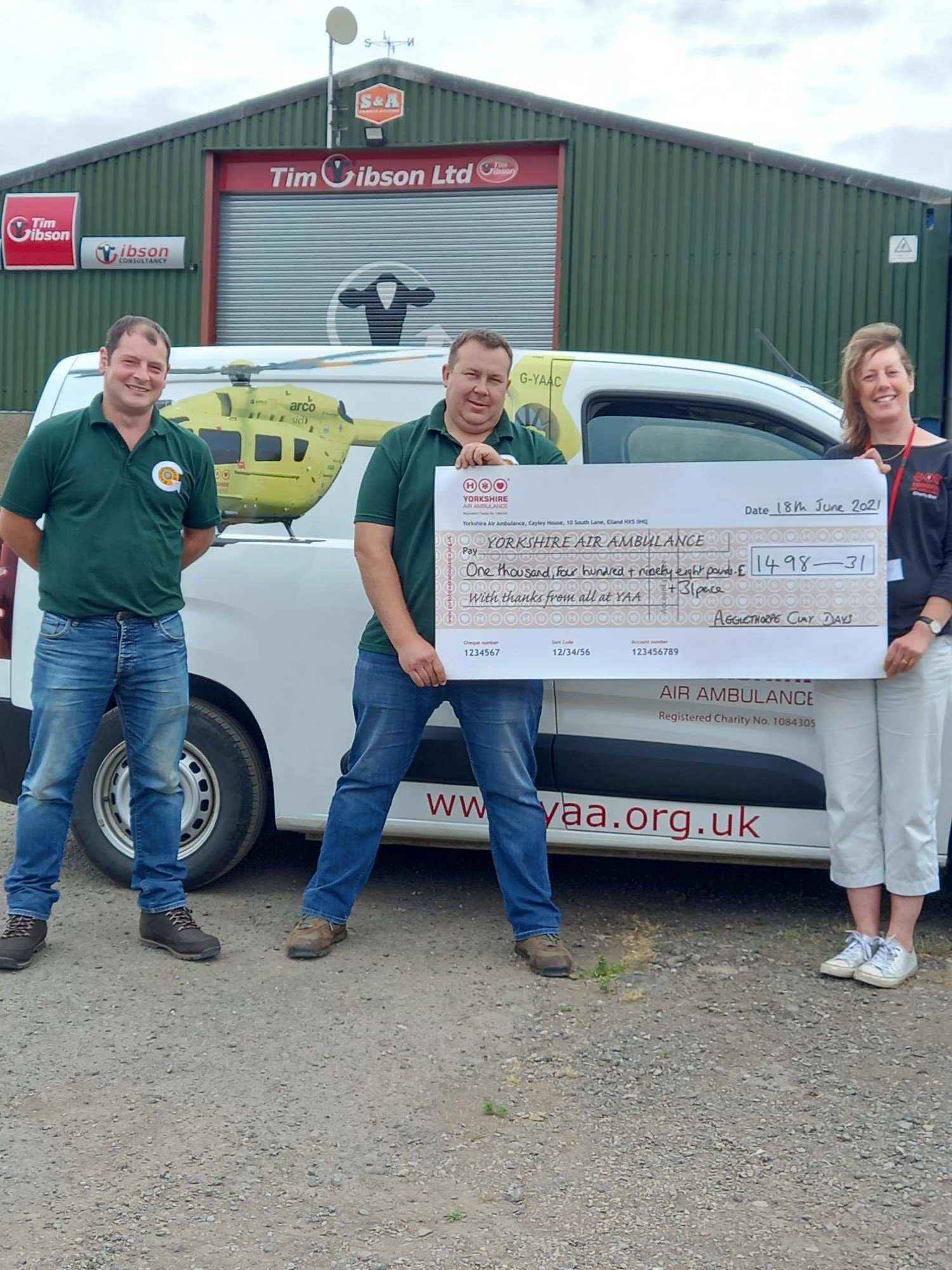 Agglethorpe Charity Clay Day staff with a cheque for the YAA