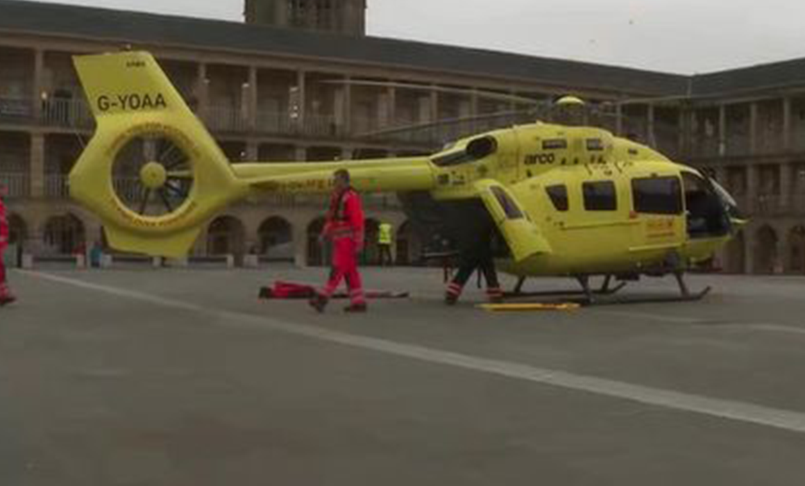 Yorkshire Air Ambulance G-YOAA in the courtyard of Halifax Grade 1 listed building The Piece Hall