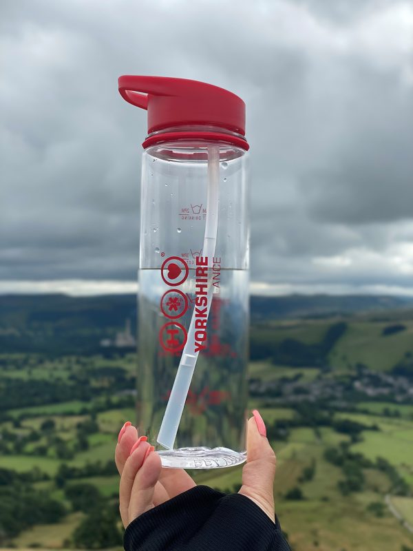 Photo of Yorkshire Air Ambulance Water Bottle being held up with fields in the background