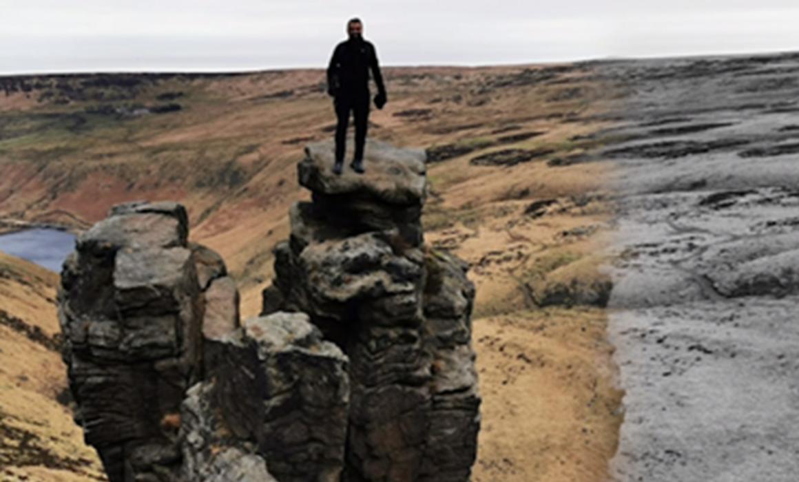Photo of Imran Choudhury stood on top of rocks at Dovestones Reservoir
